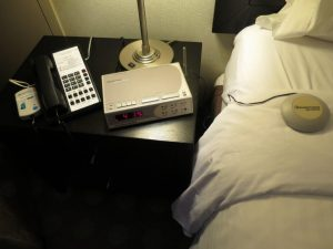 A bed shaker ensures that guests with a hearing disability are awakened when a fire alarm goes off.