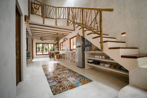 Interior of one of the rustic chic villas at Zorba Beach Homes in Tulum